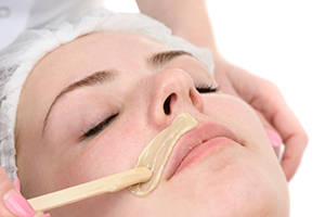 Waxing facial hair